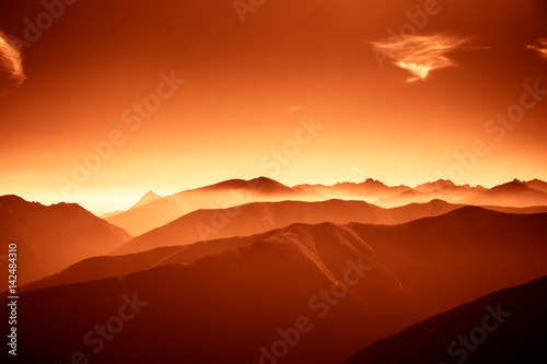 Fotobehang Rood traf. A beautiful, colorful, abstract mountain landscape in a red tonality. Decorative, artistic look.