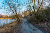 beautiful walk path in winter next to an frozen lake