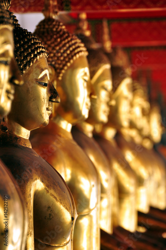 Poster Thailand, Bangkok - selective focus point on Buddha statue in Wat Arun temple of