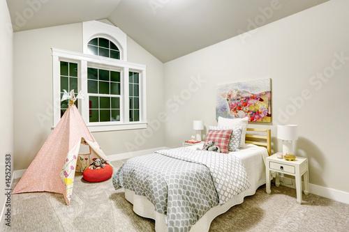 Plagát Light grey girl's bedroom features vaulted ceiling