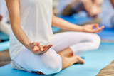 close up of woman meditating in easy sitting pose
