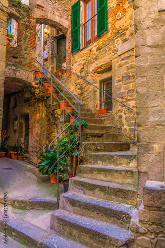 view of a narrow street waiting for tourists to come in corniglia, cinque terre, italy.