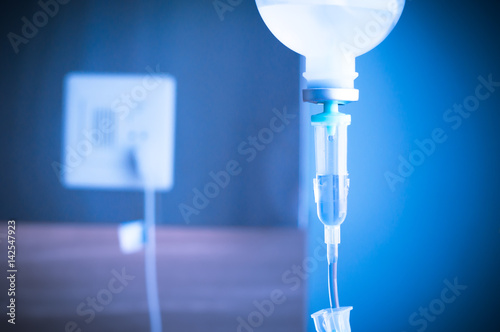 saline IV drip for patient and Infusion pump in hospital Poster