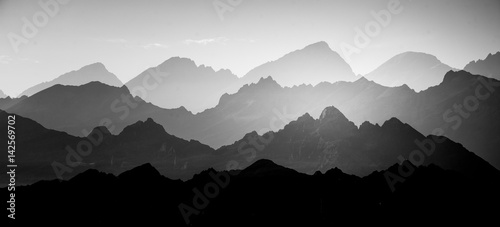 A beautiful, abstract monochrome mountain landscape. Decorative, artistic look in black and white style. - 142569702