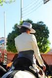Spanish woman on horseback at the fair, Feast in Spain