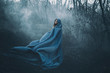A big, beautiful woman in a blue raincoat, walks in a fog. Background dark forest, bare trees. Creative colors