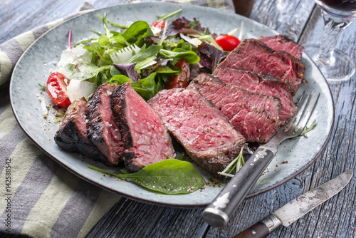 Wagyu Point Steak with Italian Salad as close-up on a plate Poster