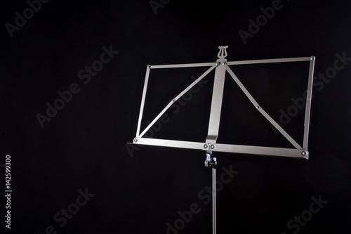 Staande foto Muziekwinkel music note stand on a black background