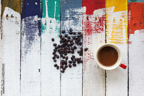coffee cup with coffee bean on colorful wooden panel