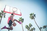 Baketball player making a dunk