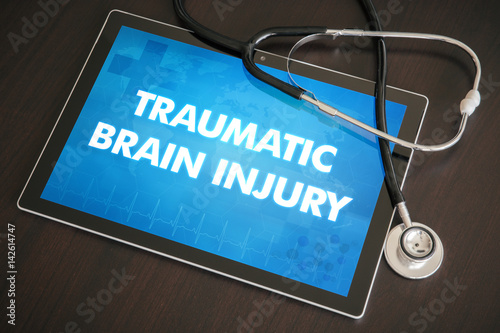 Traumatic brain injury (neurological disorder) diagnosis medical concept on tabl Poster