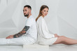 Young couple in casual clothing on white background