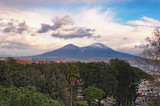 Beautiful view of the city of Napoli (Naples) and mountain Vesuvius in the background at cloudy winter day. Campania, Italy
