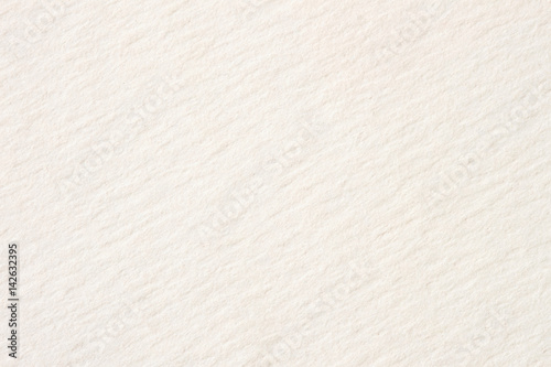 Texture of cream-coloured pastel paper for artwork close-up, light tones. For backdrop, substrate, composition use. With place for your text