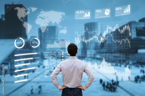 Person analyzing financial dashboard with KPI and business district background - 142639179