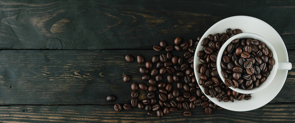 coffee beans cup on black wood top view © TKBstudio