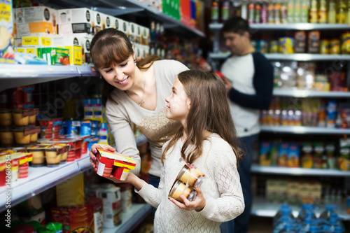 Poster Family buying pudding in shop