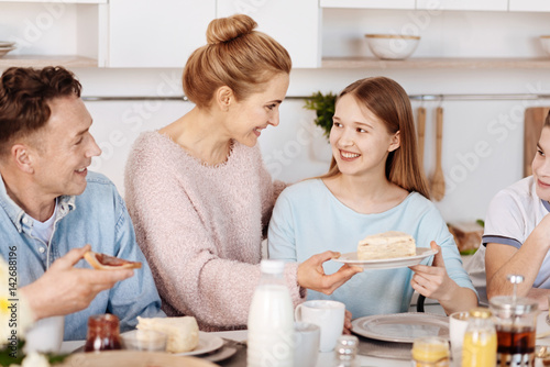 Positive family having breakfast in the kitchen © Viacheslav Iakobchuk