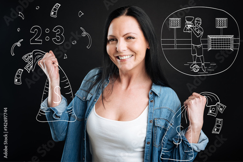 Delighted cheerful woman holding bags with money Poster