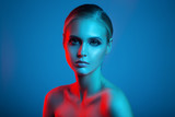 Fashion art portrait of beautiful woman face. Red and blue light color. - 142698911