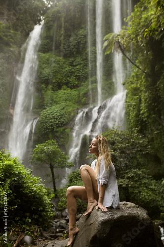 Beautiful woman and waterfall. - 142702972