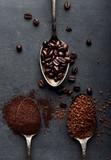 Fototapety Coffee powder, instant, beans on dark board.