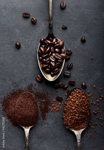 Coffee powder, instant, beans on dark board.