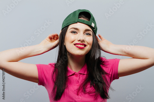 hip hop woman in green cap. Happy, gray background Poster