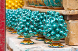 Colored pine cones in the workshop of a pottery artisan in Caltagirone, Sicily - 142727525