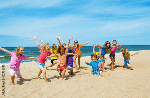 Fotografiet Active happy children on the beach