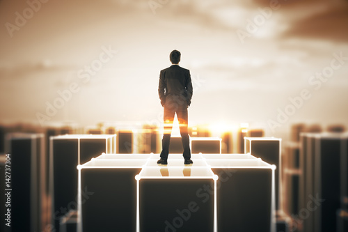 Man on abstract amber building - 142737304