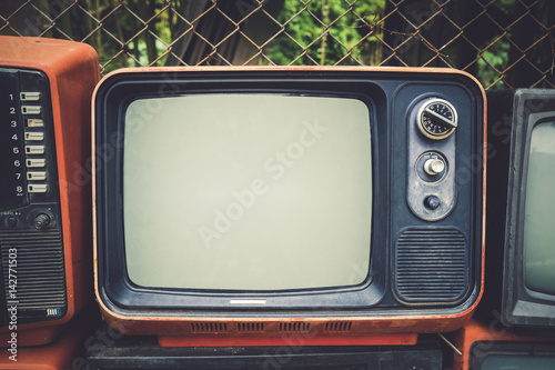 Poster Retro old television in vintage color tone effect style