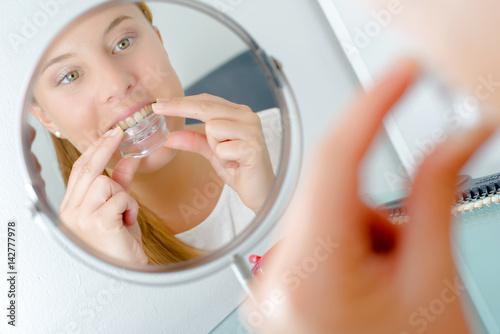 Lady fitting mouthgaurd