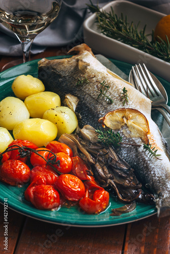 The sea bass baked with potatoes and tomatoes