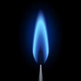 Flamme veilleuse allumée. Fond noir  - 142806730