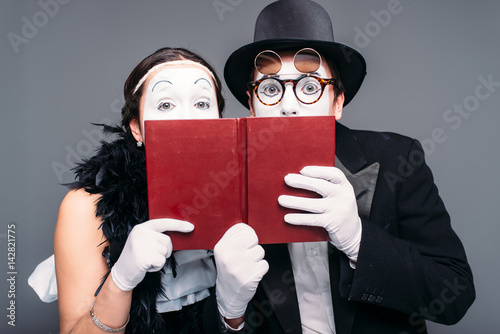 Two comedy performers posing with book Poster
