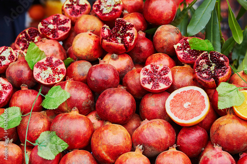 Heap of ripe pomegranates on a farmer market in Istanbul, Turkey Poster