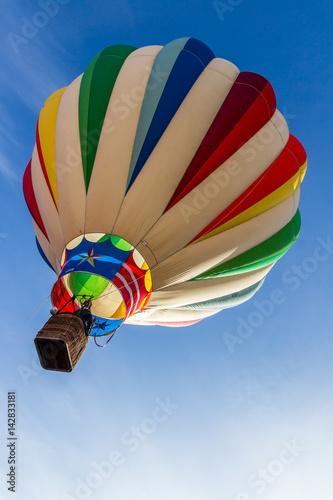 Deurstickers Ballon Hot Air Balloon Rising into a Blue Sky