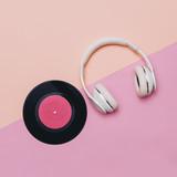 Minimal creative art. Musical retro vibrations. Headphones and vinyl. Top view - 142836360