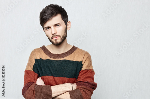 Studio portrait of young bearded hipster male looking upset, indifferent , shameful and Impolite Poster