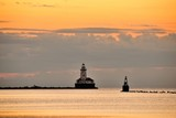 The Chicago Harbor Lighthouse at sunrise. The active, automated lighthouse sits at the end of the northern breakwater protecting the Chicago Harbor from Lake Michigan.