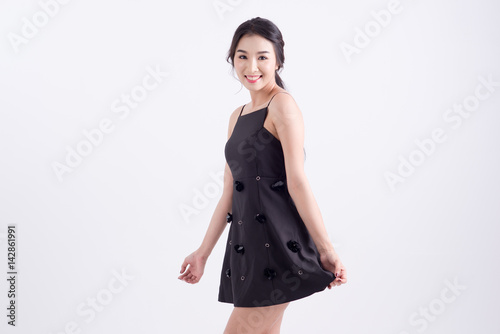 Plakat woman in black dress with white background