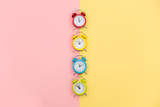 photo of colorful alarm clocks on the wonderful background in pop art style