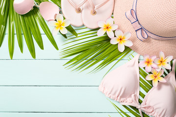 beach accessories and frangipani flowers
