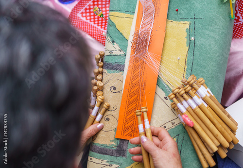 Elderly woman working on bobbin lace Poster