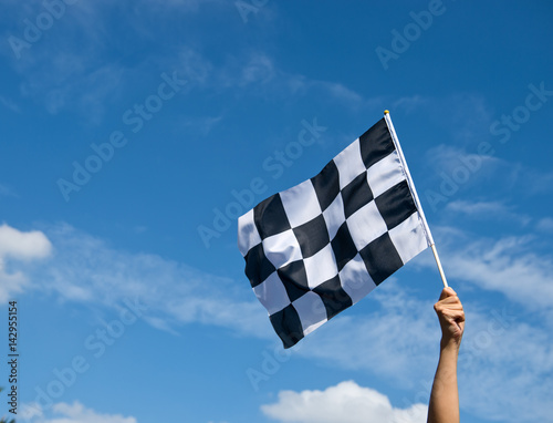 Poster checkered race flag in hand.