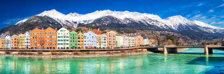 City scape in Innsbruck city center with beautiful houses, river Inn and Tyrolian Alps, Austria, Europe.