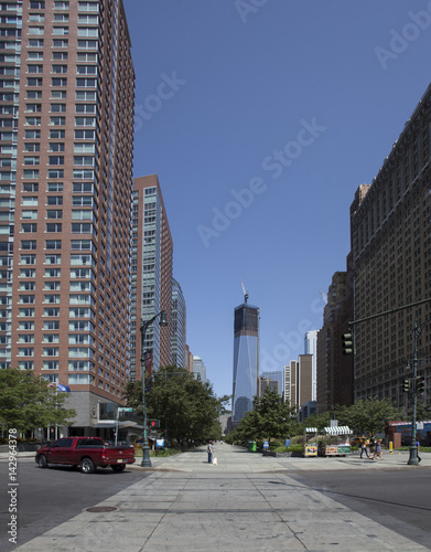 View of downtown Manhattan skyscrapers including the ongoing construction on the new World Trade Center Building in New York City Poster