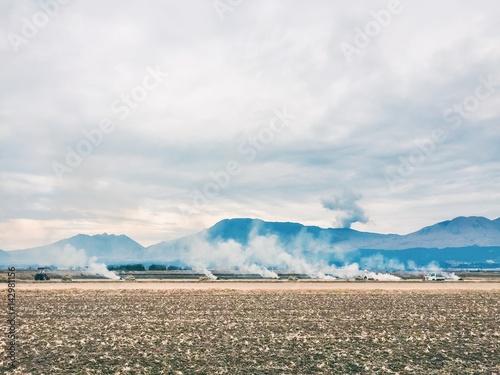 Smoke on the field, Winter, Japan Poster