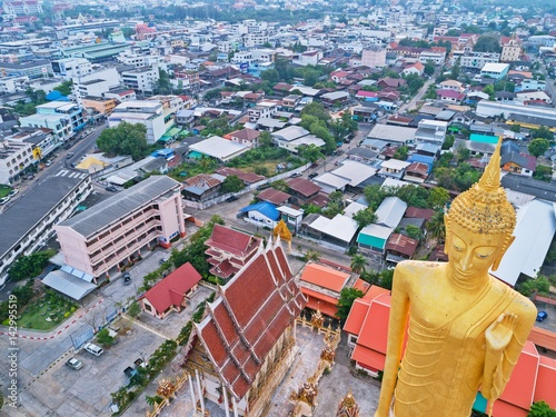 Poster Aerial view of TALLEST STANDING BUDDHA IMAGAE IN Roiet, THAILAND - BURAPAPIRAM T